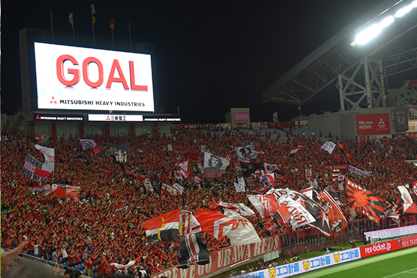 Supporters cheer as the Urawa Reds score a goal